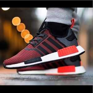 Men's black,red, and orange adidas NMD shoes